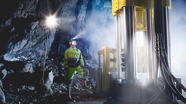Person standing in a mining environment